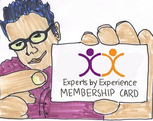 man holding a X by X membership card